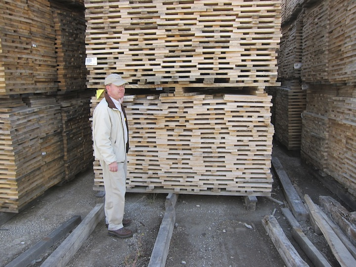 Brown-Forman Master Distiller Chris Morris Stands By Piles Of Drying Oak