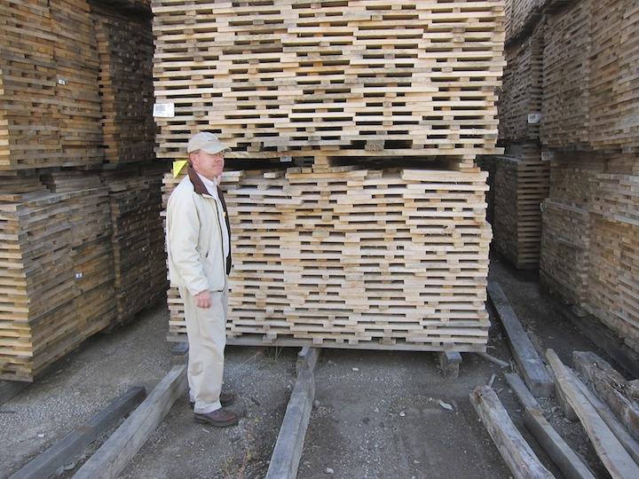 Brown-Forman Master Distiller Chris Morris Stands By Piles Of Drying Oak
