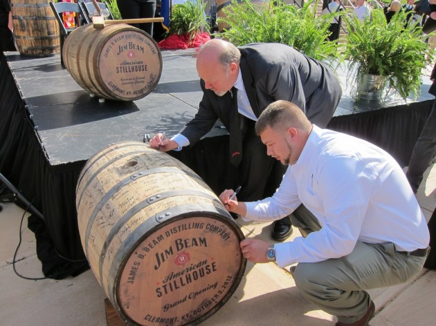 Fred and Freddy Noe Sign The Jim Beam Barrel